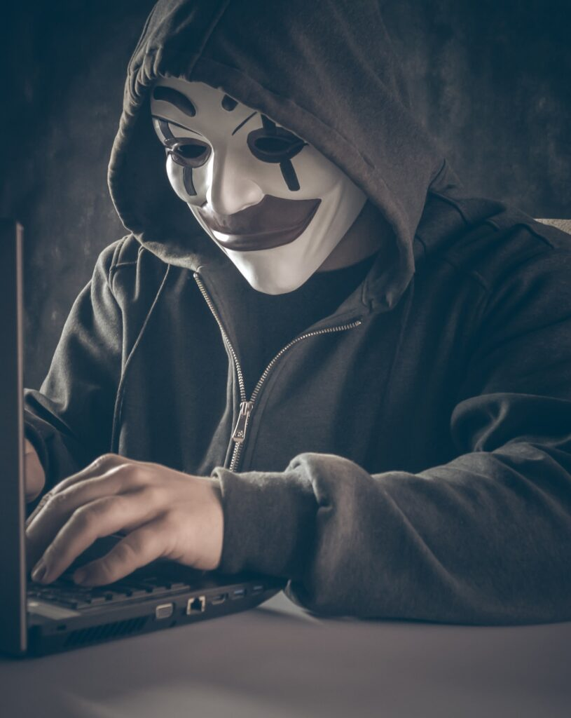 Mysterious hacker with anonymous mask