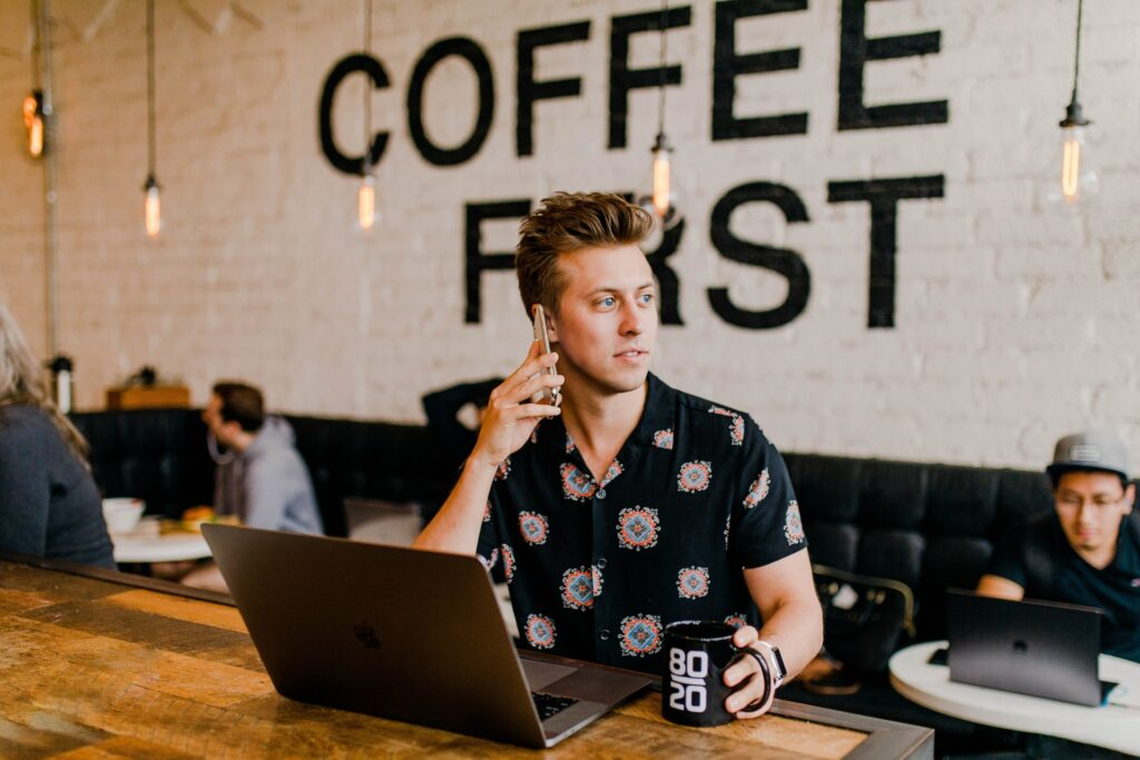 social media manager working from a coffee shop